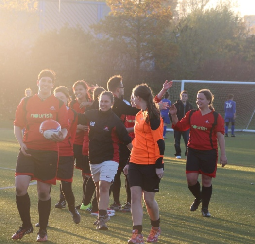 AFC Unity manager Jay Baker congratulating the team at the final whistle