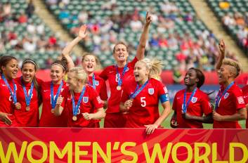 England's players celebrate their 1-0 win over Germany in the bronze medal match at the FIFA Women's World Cup in Edmonton, Alberta on July 4, 2015. AFP PHOTO/GEOFF ROBINS